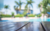 Blur wooden table on pool background, selection focus shameless wooden table,