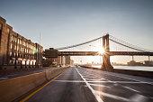 Blured FDR and Manhattan bridge at sunrise
