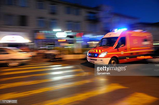 Blurred ambulance racing through the streets of Marseilles