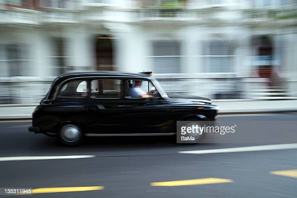 Blurred Black Taxi Cab on London Street