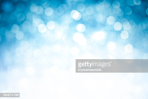 Blurred blue sparkles background with darker top corners