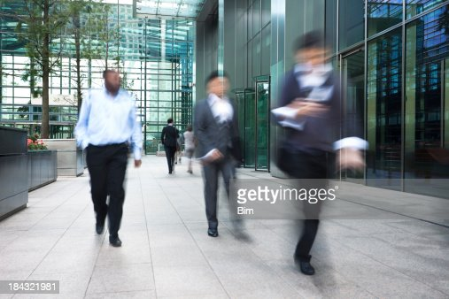 Blurred Business People Walking Fast in Financial District