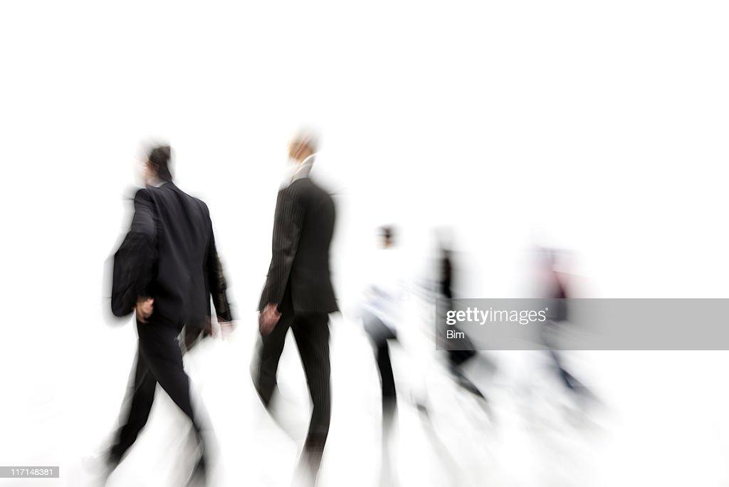 Blurred Businessmen Walking in Corridor : Stock Photo