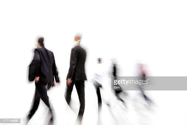 Blurred Businessmen Walking in Corridor