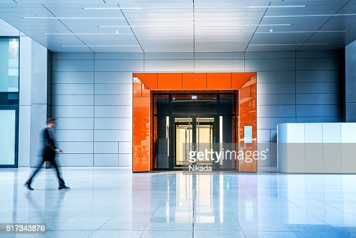 Blurred businessmen walking inside a modern building