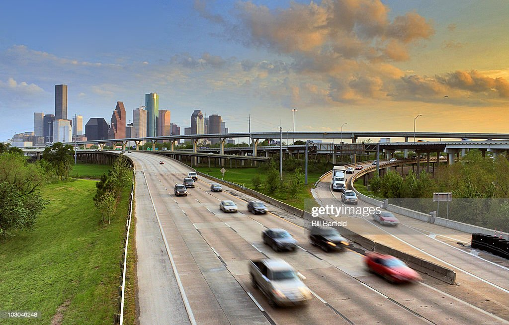 Blurred cars on freeway leaving downtown area