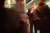 Blurred commuter on subway station
