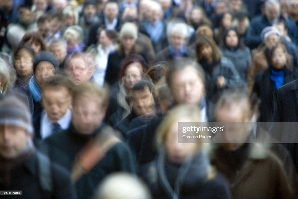 Blurred commuters in rush hour : Stock Photo