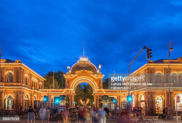 Blurred crowds at Tivoli Gardens at night, Copenhagen, Zealand, Denmark