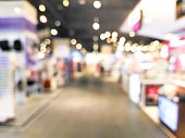 Blurred decorative and colorful shopping mall with bokeh light
