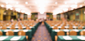 Blurred, defocused background of modern conference room or university lecture hall. Company business meeting, convention center, education, financial economic forum, or organization event concept
