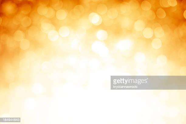 Borrosa fondo oscuro sparkles oro con las esquinas