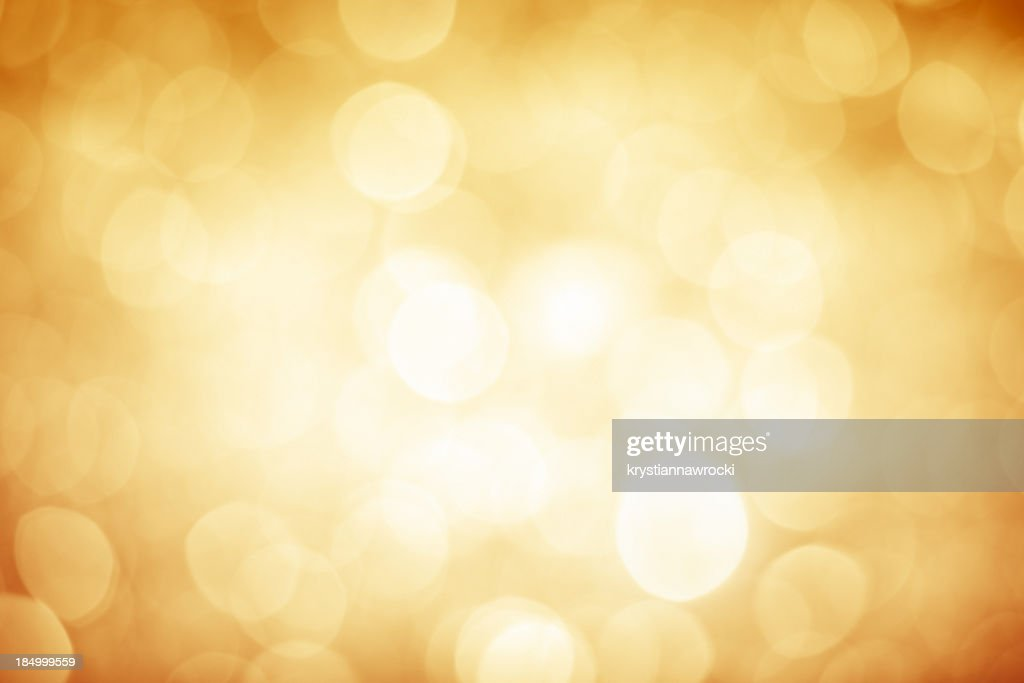 Blurred gold sparkles