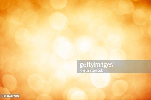 Offuscata luccica d'oro sfondo con angoli più scura e luminoso centro