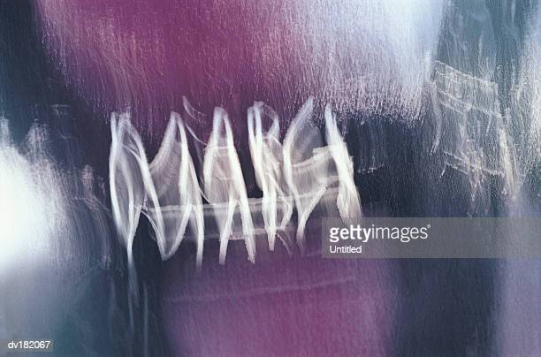 Blurred handwriting on a purple and silver background