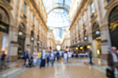 Blurred image bokeh of People walking around Galleria Vittorio Emanuele II, one of the world's oldest shopping malls.