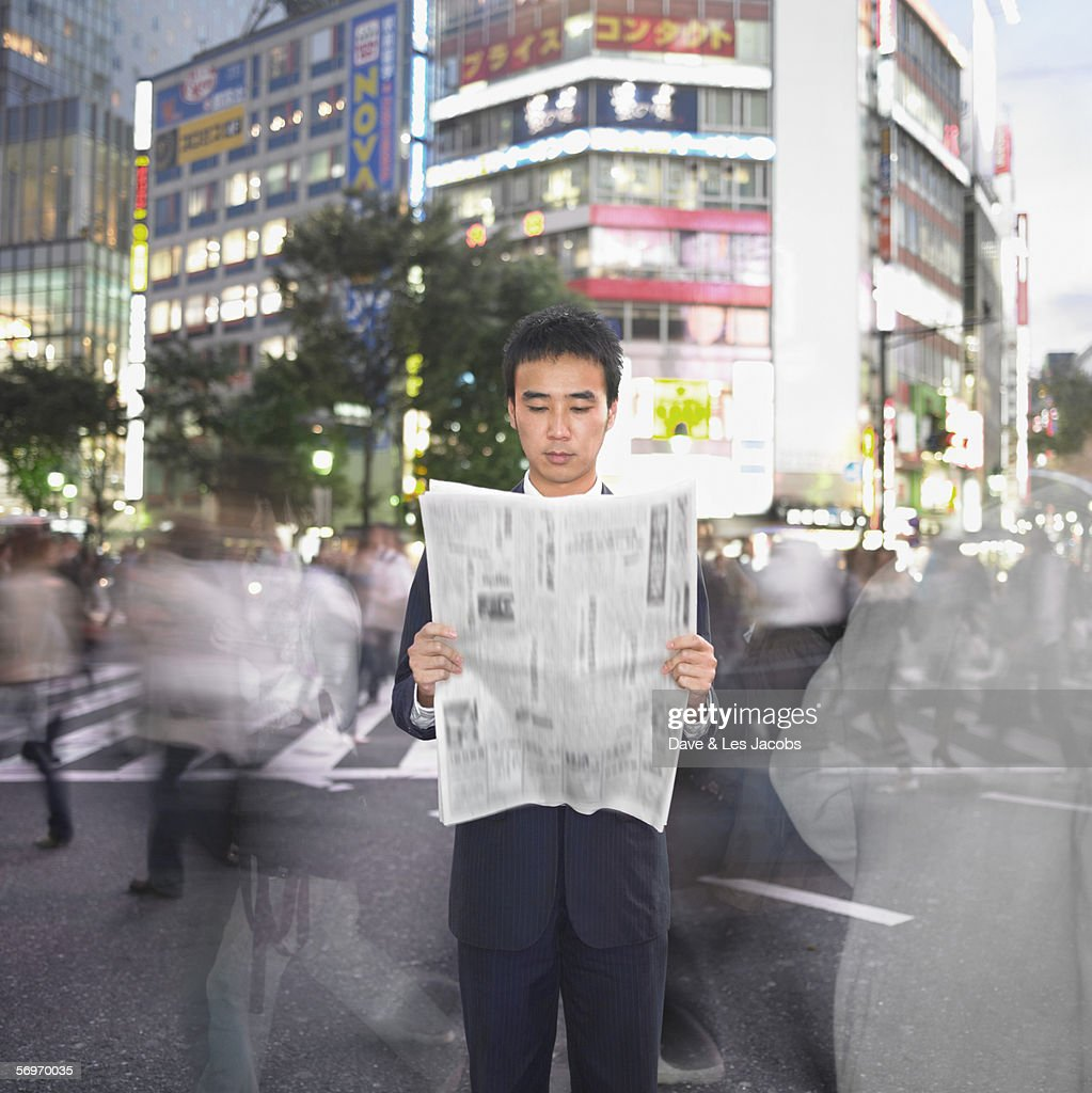 Blurred image of businessman reading newspaper : Stock Photo