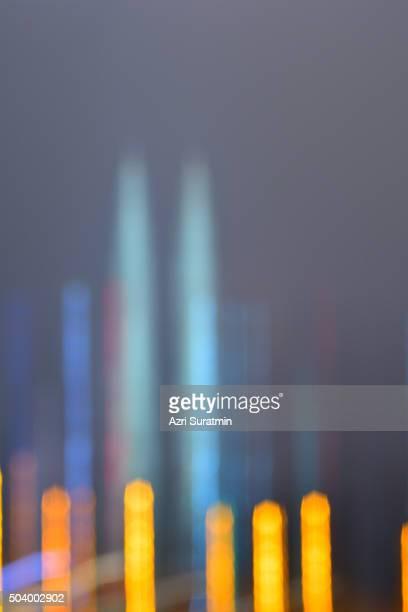 Blurred image of Kuala Lumpur at night with light movement effect
