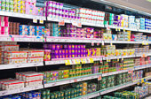 Blurred image of shelves with milk products in supermarket.