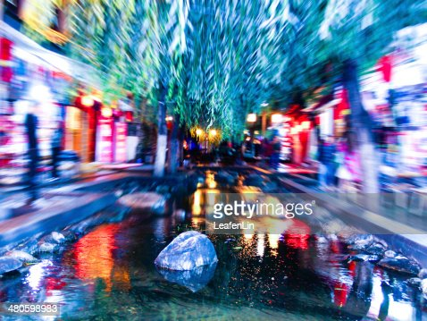 Blurred lights at night ,Lake reflecting the trees and stones : Stock Photo