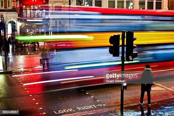 Blurred London bus at night