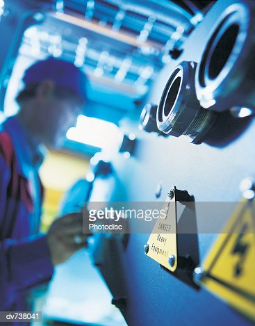 Blurred Man Working With Dangerous Equipment in Factory