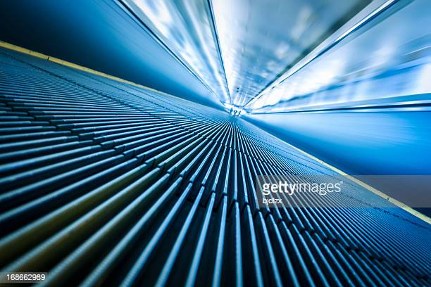 blurred motion of airport moving walkway