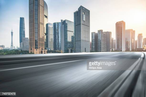 Blurred motion of asphalt road with Guangzhou TV Tower in background, Guangzhou, Guangdong, China