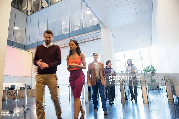 Blurred motion of business people walking in office lobby