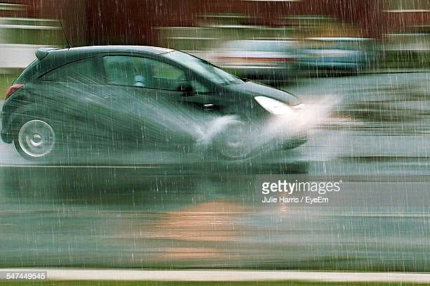 Blurred Motion Of Car On Street During Rainy Season