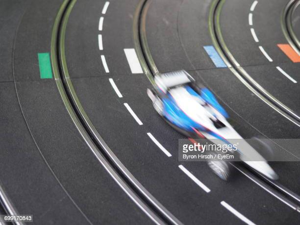 Blurred Motion Of Electric Slot Car On Race Track