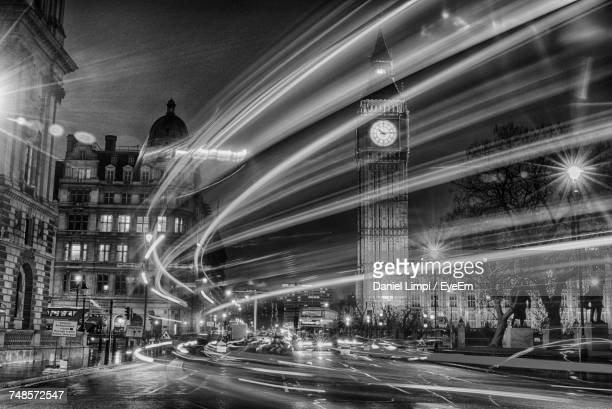 Blurred Motion Of Light Trails Against Big Ben At Night