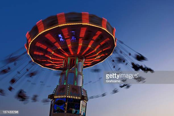Blurred motion of merry-go-round chairoplane at night