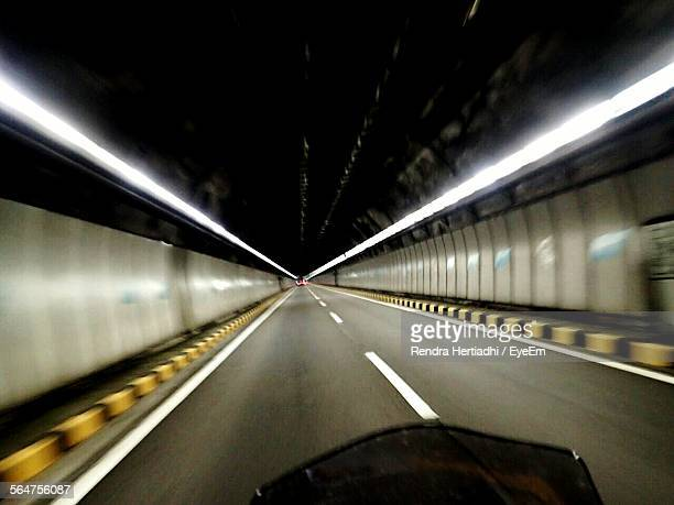 Blurred Motion Of Motorcycle Moving On Tunnel Road