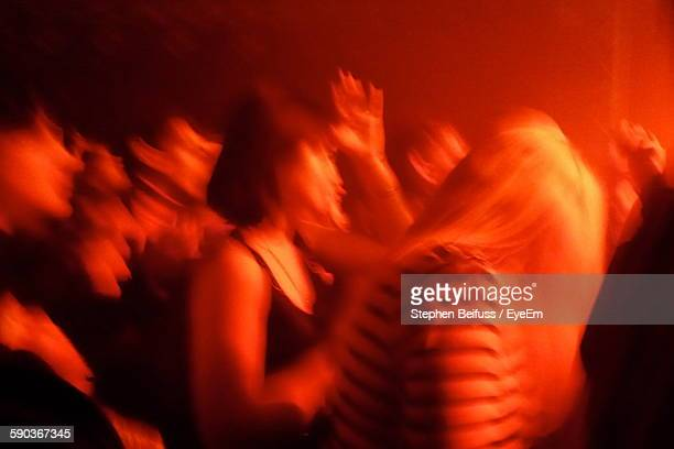Blurred Motion Of People Dancing At Music Concert