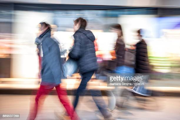 Blurred Motion Of People Walking In City