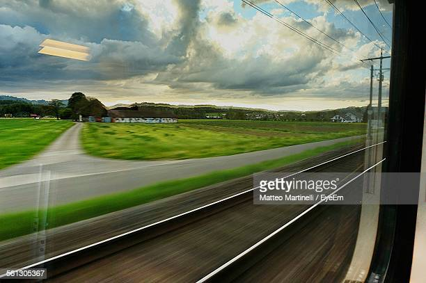 Blurred Motion Of Railroad Track Seen Through Train Window