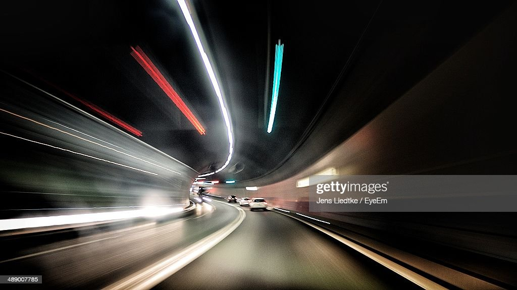 Blurred motion of road tunnel at night