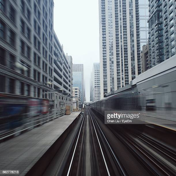 Blurred Motion Of Train Moving On Railroad Track