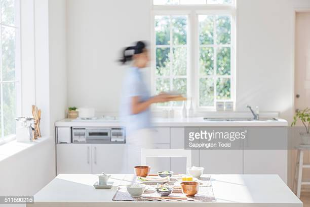 Blurred Motion Of Woman Holding Tray