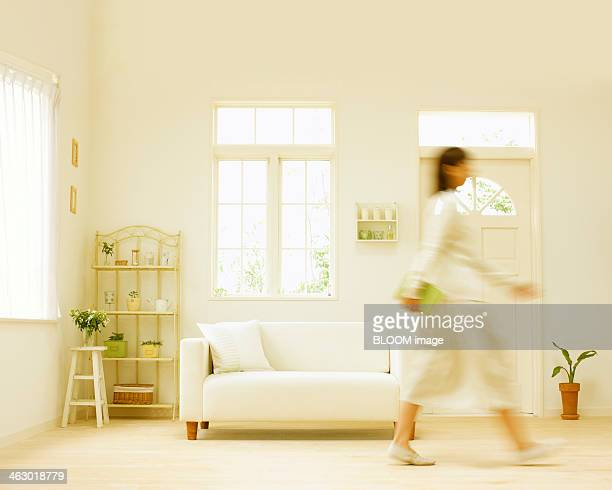 Blurred Motion Of Woman In Living Room