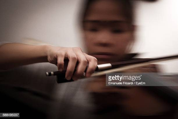 Blurred Motion Of Woman Playing Violin