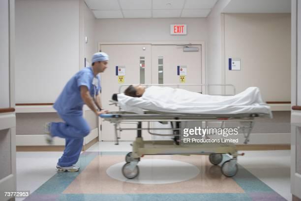 Blurred motion shot of nurse wheeling gurney in hospital