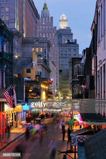 Blurred motion view of tourists on Bourbon Street at night, New Orleans, Louisiana, United States