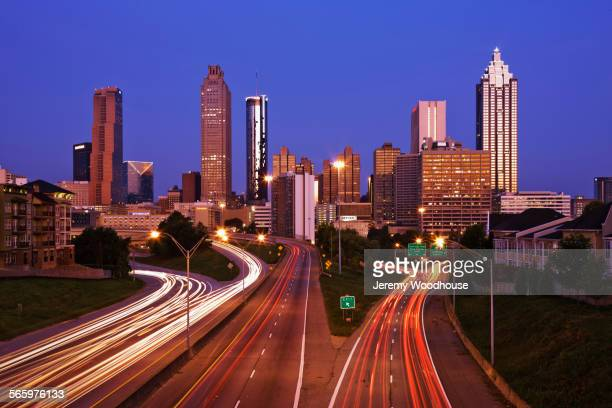 Blurred motion view of traffic and Atlanta cityscape at night, Georgia, United States