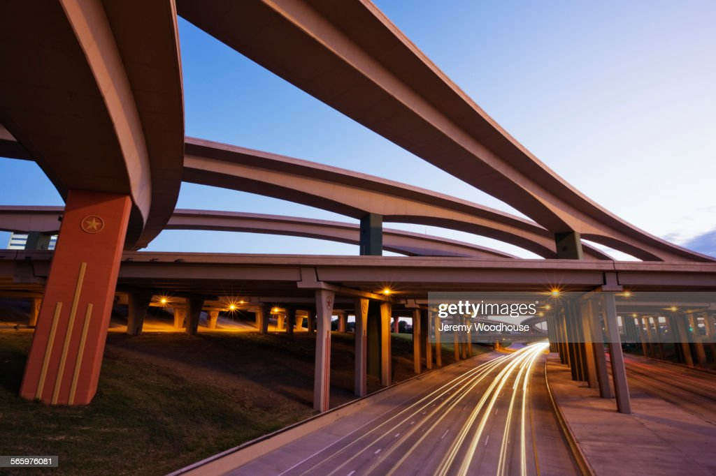 Blurred motion view of traffic driving on highway underpass