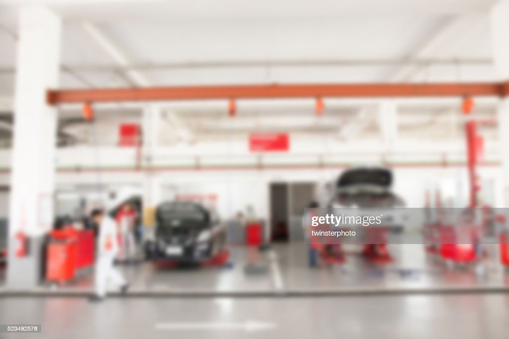 Verschwommene Von Innen Auto Garage Mit Autos, Renoviert