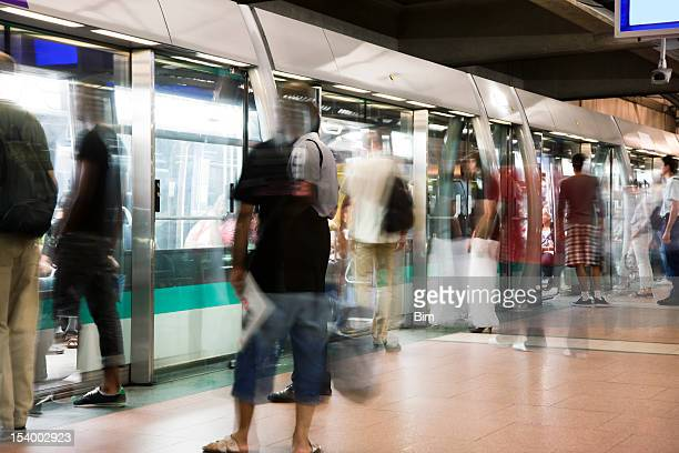 Blurred People Getting Into Subway Train During Paris Rush Hour