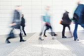 blurred people walking in a corridor