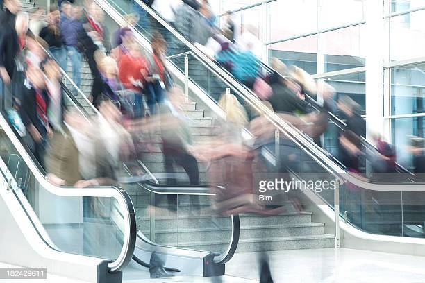 Blurred People on Stairs and Escalators